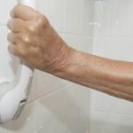 hand grasping safety handlebar