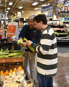 SAGE Eldercare grocery shopping volunteers Judy and Chris in ShopRite of Stirling
